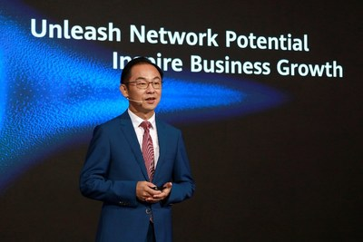 Ryan Ding delivers a keynote speech