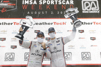 Helio Castroneves and Ricky Taylor celebrate their win Sunday at Road America in Elkhart Lake, Wisconsin. (PRNewsfoto/Acura Motorsports)