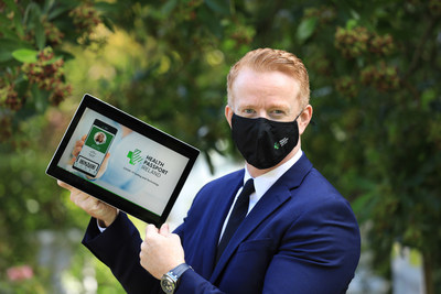 Robert Quirke, President & CEO of Irish-based ROQU Group, displays the world-first 'Health Passport' platform which has been specifically engineered to support increased COVID-19 testing. (PRNewsfoto/ROQU Group)