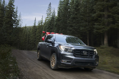 The 2021 Honda Ridgeline begins arriving at Honda dealerships on Feb. 2, with bold new styling underscoring its rugged and versatile pickup truck capabilities. Ridgeline's standard V6 power, fully independent suspension and standard torque-vectoring i-VTM4® all-wheel drive give it the capability to tackle challenging trails and treacherous roads with class-leading ride and handling. Manufacturer's Suggested Retail Prices (MSRP) start at $36,490. (PRNewsfoto/American Honda Motor Co., Inc.)