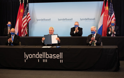LyondellBasell's Torkel Rhenman, Executive Vice President, Global Intermediates and Derivatives, displays a signed agreement with Sinopec to form a 50:50 joint venture (JV) in Houston, Texas